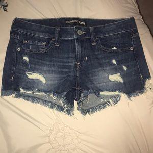 Express dark jean shorts. Size 4.